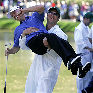 Ben Crane is congratulated by Drew Bledsoe, quarterback for American Football team the Dallas Cowboys, who was his caddie
