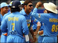 Yuvraj celebrates with team-mates