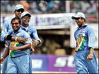 Rahul Dravid (R) runs to join in some Indian celebrations