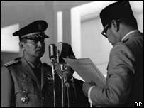 Suharto is sworn in to the cabinet in 1966 by Sukarno