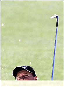 Ian Woosnam plays out of a bunker on the first