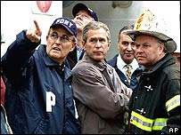 Rudolph Giuliani, President George W Bush with New York City Fire Commissioner Thomas Van Essen, days after the attacks