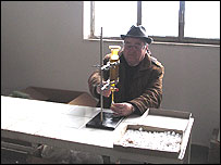 Mr Crispo fills bottles with bergamot oil