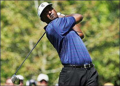 Vijay Singh drives down the seventh fairway