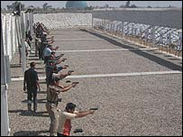 Recruits at Baghdad police academy in shooting practice