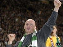 John Hartson celebrates winning the title