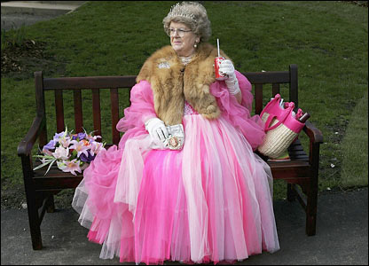 A lady race-goer on a bench ahead of the racing