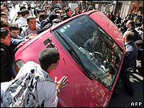 Angry students overturning car which drove into crowd