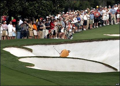 John Daly play out of a bunker on the first hole