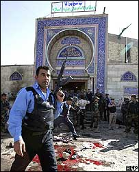 A policeman outside the mosque in the aftermath of the bombing