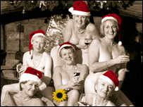 The Calendar Girls pose nude in Christmas hats for December