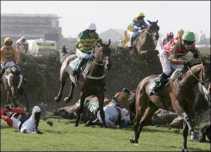 Horses and jockeys fall at Bechers Brook