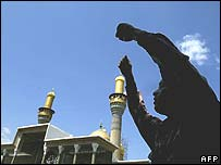 A worshipper at the shrine of Imam Mussa al-Kazem in Baghdad during Friday noon prayers