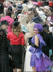 Race goers await the chance to join the fashion show in Red Rum Garden