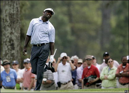 Vijay Singh watches after playing an iron on the first