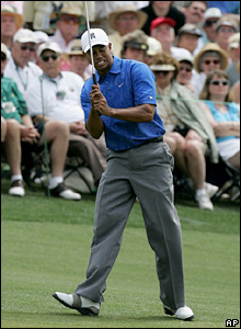 Tiger Woods reacts after missing a putt on the first