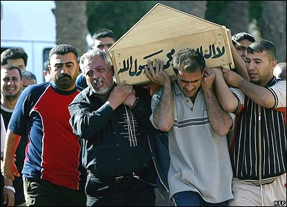 Mourners carry victim's coffin