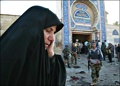 Iraqi woman on phone outside the attacked mosque