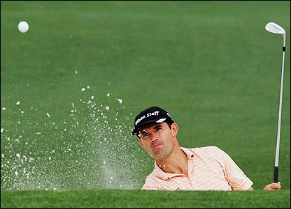 Padraig Harrington of Ireland plays out of the bunker on the second green