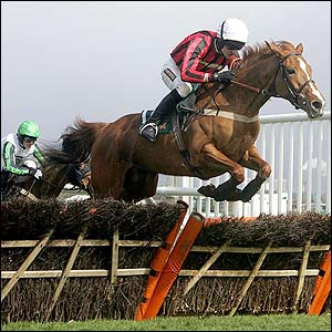 Ruby Walsh and Asian Maze win the Aintree Hurdle