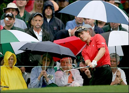 Luke Donald plays an approach shot to a green