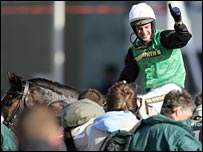 Niall Madden celebrates his Grand National win on Numbersixvalverde