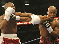 Zab Judah (right) takes a left from Floyd Mayweather