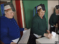 Hungarian women, wearing traditional dress, vote in polling station in Holloko