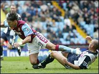 Albion's Ronnie Wallwork fouls Villa's Milan Baros