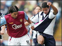 Villa's Milan Baros and Albion's Curtis Davies