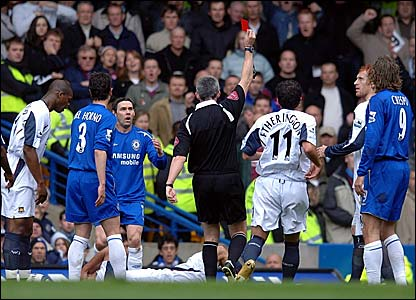 Referee Chris Foy dismisses Nuno Maniche (third left) with Lionel Scaloni on the floor