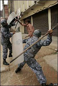 Riot policemen beat protester in Kathmandu
