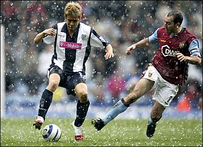 Junichi Inamoto (left) and Gavin McCann battle for the ball in a hailstorm at Villa Park