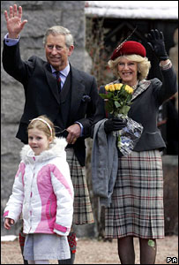 Prince Charles and Camilla with Heather Small, six, of Glasgow, outside Crathie Parish Church, Balmoral