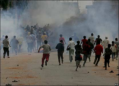 Protesters flee tear gas