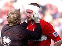 Boro's Frank Queudrue receives treatment for a head injury