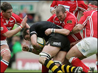 Scarlets defenders attempt to stop Wasps lock Simon Shaw