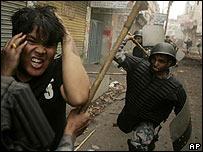Policeman beats protester in Kathmandu on Sunday