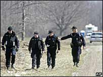 Toronto police search fields where bodies were found