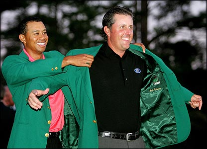 Tiger Woods puts the green jacket on Phil Mickelson