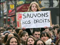 Student carries banner saying 'Save our rights' during a demonstration in Paris in March