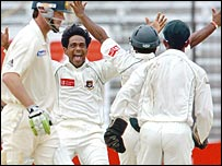 Mohammad Rafique celebrates the wicket of Damien Martyn