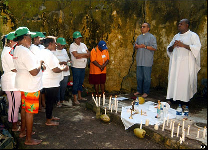 Chagossians take part in a communion mass