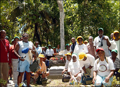 The visitors dedicate a memorial stone on Diego Garcia