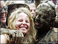 Festival-goers covered in mud at Glastonbury 2005
