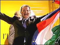 L'Unione center-left coalition leader Romano Prodi raises an Italian and EU flag