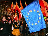 File photograph of Orange Revolution supporters waving orange flags and the EU flag
