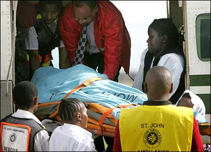 A stretcher is removed from a plane carrying survivors of the Marsabit plane crash.