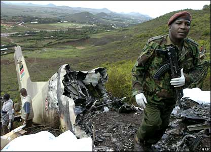 A Kenyan soldier and rescue workers at the site where a military plane crashed near Marsabit, northern Kenya.