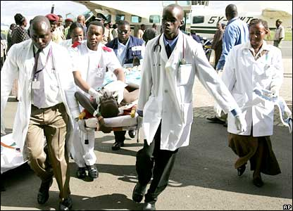 Medical workers in Nairobi carry a survivor from the plane crash